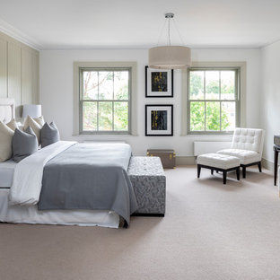 This Is An Example Of A Large Traditional Master Bedroom In London With White Walls