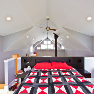 Bedroom - contemporary loft-style light wood floor bedroom idea in Calgary with gray walls