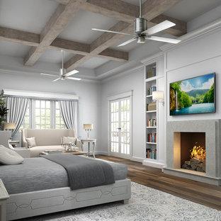 Idéer för ett stort klassiskt huvudsovrum, med grå väggar, mellanmörkt trägolv, en öppen vedspis och en spiselkrans i betong
