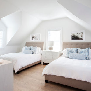 Coastal guest light wood floor bedroom photo in Boston with white walls and no fireplace