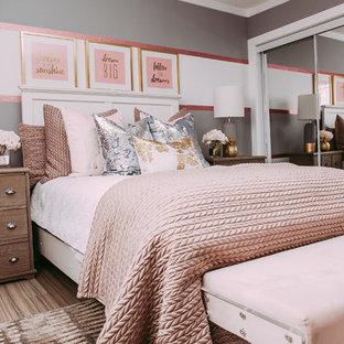 Bedroom - small transitional guest laminate floor bedroom idea in Edmonton with gray walls
