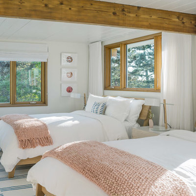 Inspiration for a large coastal guest bedroom remodel in Boston with white walls
