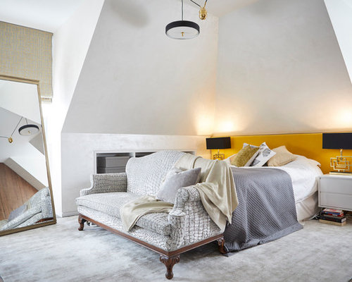 Eclectic Master Bedroom In London With White Walls, Dark Hardwood Flooring  And Brown Floors.