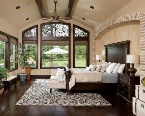 Example Of A Large Tuscan Master Dark Wood Floor Bedroom Design In Houston  With Beige Walls Part 19