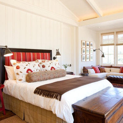 Example of a classic medium tone wood floor bedroom design in San Francisco with white walls