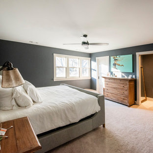 This is an example of a large arts and crafts master bedroom in Chicago with grey walls, linoleum floors and beige floor.