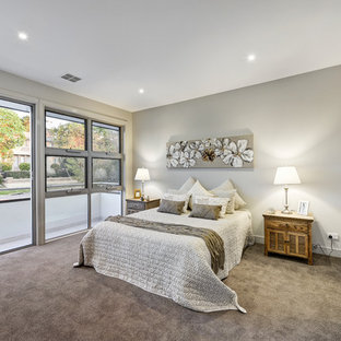 Design ideas for a mid-sized contemporary master bedroom in Melbourne with carpet, grey walls, no fireplace and grey floor.