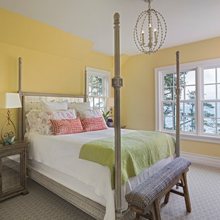 Design ideas for a beach style bedroom in Detroit with yellow walls, carpet and grey floor.