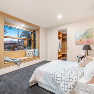 Design ideas for a scandinavian master bedroom in Melbourne with white walls, carpet and grey floor.