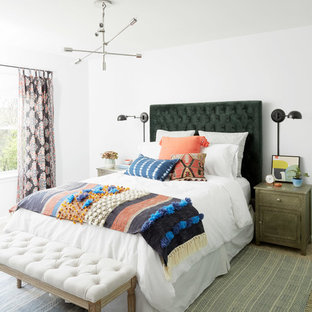 Example of an eclectic guest bedroom design in Nashville with white walls