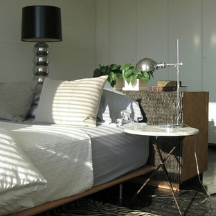 Design ideas for a small midcentury master bedroom in Chicago with white walls and linoleum floors.