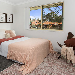 Photo of a beach style guest bedroom in Gold Coast - Tweed with white walls, carpet and grey floor.