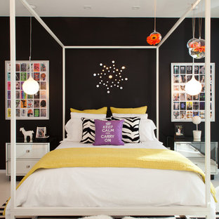Photo of a large contemporary bedroom in Miami with black walls and no fireplace.