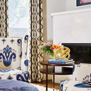 Пример оригинального дизайна: огромная хозяйская спальня в классическом стиле с серыми стенами, паркетным полом среднего тона, стандартным камином, фасадом камина из камня и коричневым полом