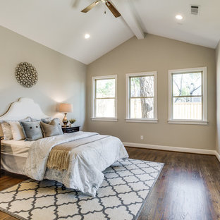 Example of a mid-sized transitional master medium tone wood floor bedroom design in Dallas with gray walls and no fireplace