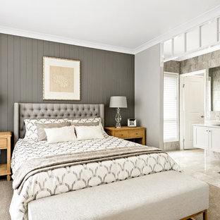 Modern master bedroom in Other with grey walls, carpet and beige floor.