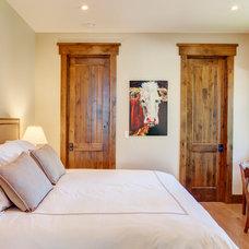Rustic Bedroom by McKinney Group, Inc