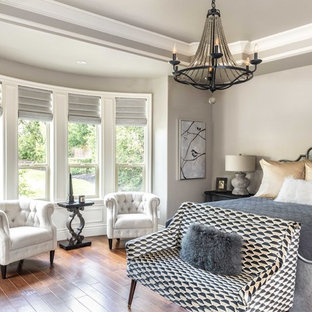 French country dark wood floor and brown floor bedroom photo in Sacramento with beige walls