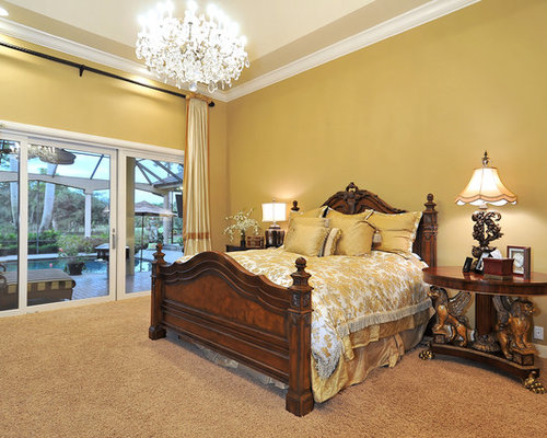 Traditional Carpeted Bedroom Idea In Tampa With Yellow Walls