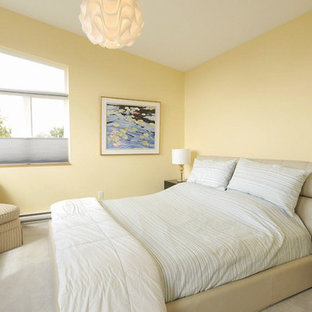 Example of a mid-sized minimalist master carpeted bedroom design in Vancouver with yellow walls and no fireplace