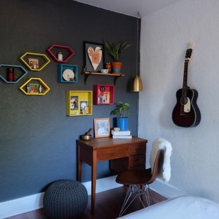 Inspiration for a small 1960s master dark wood floor bedroom remodel in Los Angeles with white walls