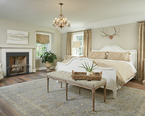 traditional bedroom design. Example Of A Large Classic Master Medium Tone Wood Floor Bedroom Design In Grand Rapids With Traditional