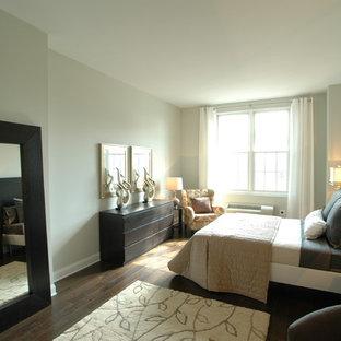 Trendy dark wood floor bedroom photo in Sacramento with gray walls
