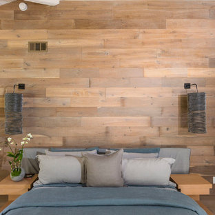 Inspiration for a beach style bedroom in Los Angeles with brown walls.
