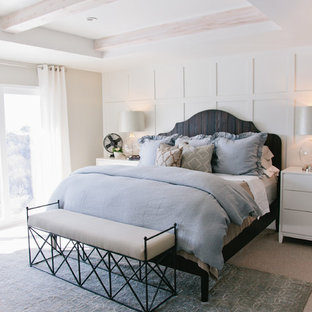 Example of a mid-sized transitional master carpeted bedroom design in Salt Lake City with beige walls