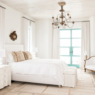 Bedroom - mid-sized mediterranean guest limestone floor bedroom idea in Houston with white walls and no fireplace