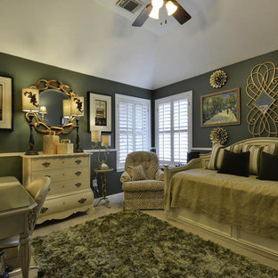 Large transitional guest carpeted bedroom photo in Austin with green walls