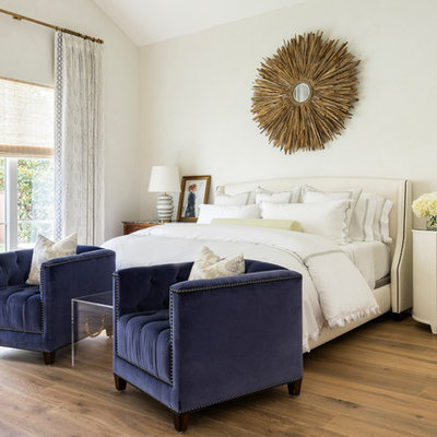 Bedroom - transitional master medium tone wood floor bedroom idea in Houston with beige walls and no fireplace