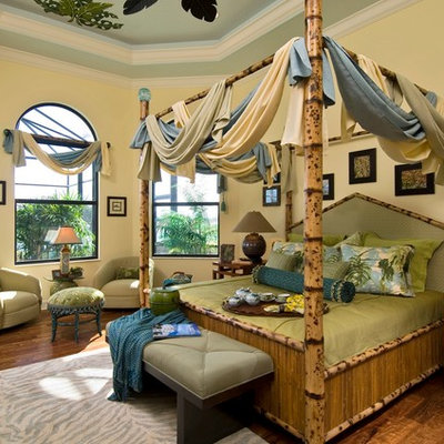 Island style bedroom photo in Miami with yellow walls