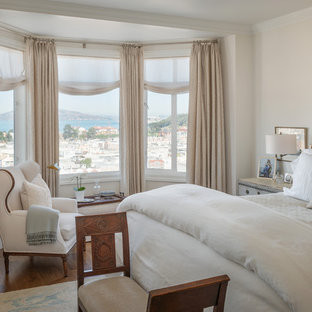 Design ideas for a traditional bedroom in San Francisco with beige walls and medium hardwood floors.