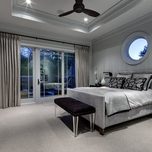 Trendy carpeted bedroom photo in Dallas with gray walls
