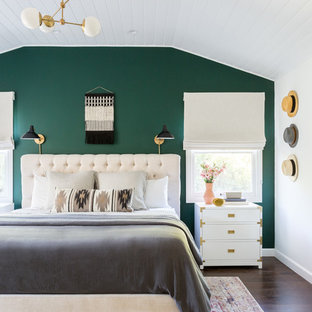 Design ideas for a beach style master bedroom in Los Angeles with green walls, dark hardwood floors and no fireplace.