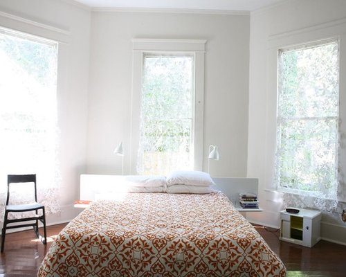 trendy bedroom photo in new york with white walls - Church Pews For Sale