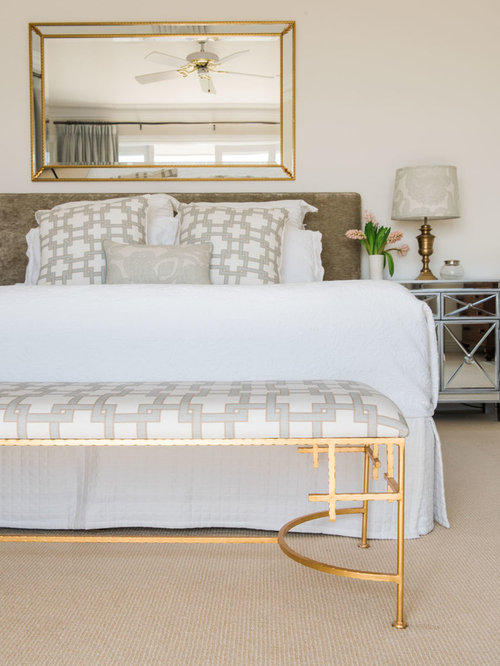 This Is An Example Of A Large Traditional Master Bedroom In Brisbane With Carpet White