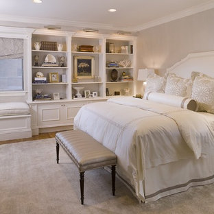 Inspiration for a large timeless master medium tone wood floor bedroom remodel in New York with no fireplace and gray walls