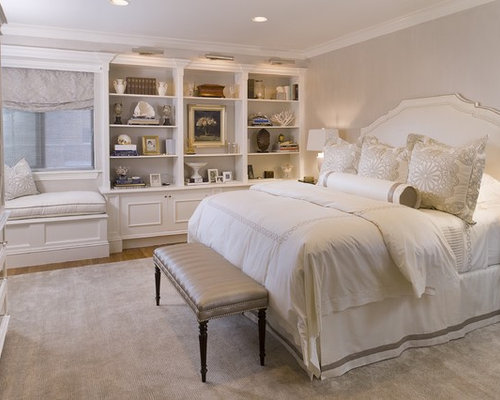 inspiration for a large timeless master medium tone wood floor bedroom remodel in new york with