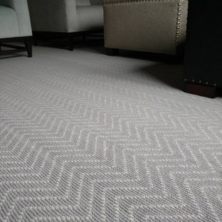 Inspiration for a mid-sized modern master carpeted and gray floor bedroom remodel in Detroit with gray walls