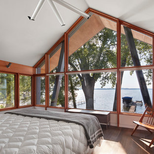 Example Of A Mountain Style Master Brown Floor And Medium Tone Wood Bedroom Design In