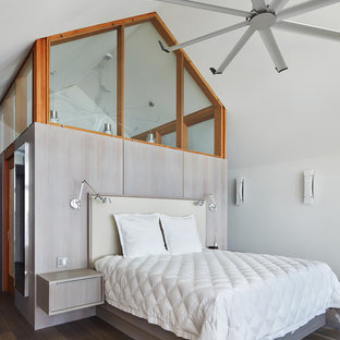 Bedroom - small contemporary master medium tone wood floor and brown floor bedroom idea in Minneapolis with white walls