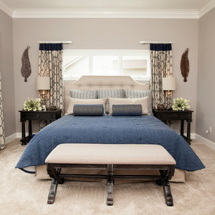 Photo of a mid-sized transitional master bedroom in Other with grey walls, carpet, no fireplace and beige floor.