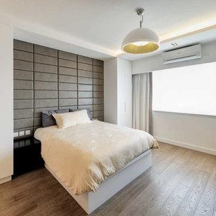 Example of a zen bedroom design in Hong Kong