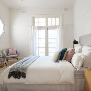 This is an example of a transitional bedroom in Melbourne.