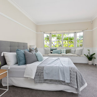 Photo of a large transitional master bedroom in Sydney with carpet, grey floor, beige walls and no fireplace.