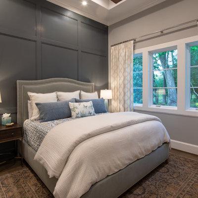 Bedroom - transitional dark wood floor and brown floor bedroom idea in Houston with gray walls