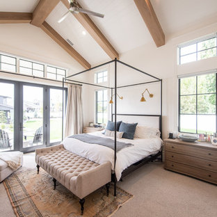 Bedroom - cottage carpeted and beige floor bedroom idea in Salt Lake City with white walls