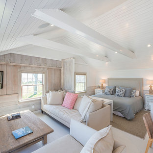 Inspiration for a beach style painted wood floor and white floor bedroom remodel in New York with white walls